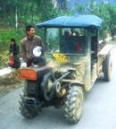 Typical transport in the countryside of Yangshuo; a cross between a tractor, and ATV, and a pick-up. Note the exposed fly-wheel in the front.